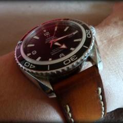 omega planet ocean sur bracelet montre cuir canotage modèle orcade