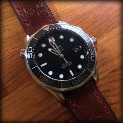 omega seamaster sur ammo canotage fil rouge
